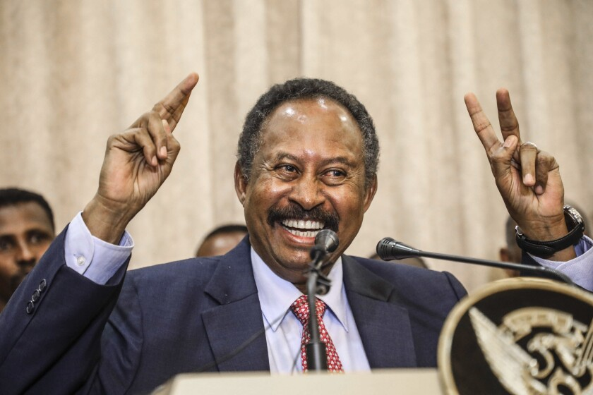 FILE - In this Wednesday, Aug. 21, 2019 file photo, Sudan's new Prime Minister Abdalla Hamdok speaks duringa press conference in Khartoum, Sudan, Wednesday, Aug. 21, 2019. For the first time in three decades, Sudan has charted a path out of military rule with the formation of a transitional government in which power is shared with civilians. But the fragile transition will be tested as leaders confront a daunting array of challenges. Decades of war and corruption have left the economy in shambles, and a U.S. terror designation has hindered Sudan's return from its longtime status as a global pariah. (AP Photo, File)