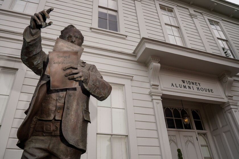 A statue of Judge Robert Widney stands in front of the Widney Alumni House