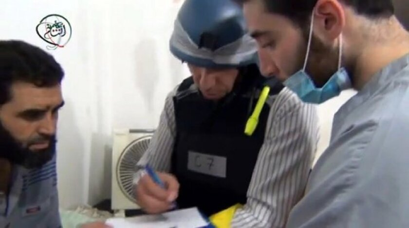 Amateur footage posted on YouTube on Monday was said to show a U.N. inspector interviewing residents about an alleged chemical attack in the Damascus suburb of Muadhamiya.