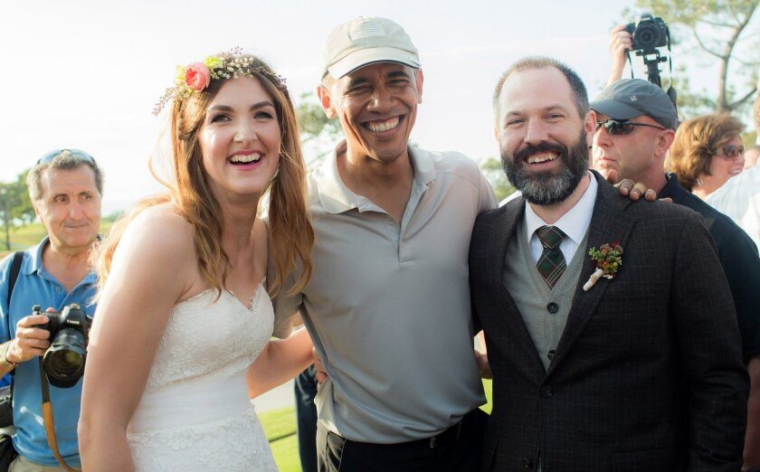 """Stephanie and Brian Tobe hug President Barack Obama, who was playing a round of golf at Torrey Pines on Sunday and """"crashed"""" their wedding reception, at the Lodge."""