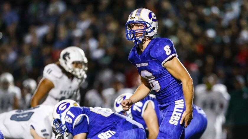 Grossmont quarterback Jamie Odom motions to a receiver before the snap during a play in the first quarter.