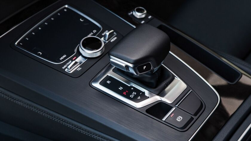 The center console is broad but most of the space is consumed by the gear shift and 5-by-5-inch fing