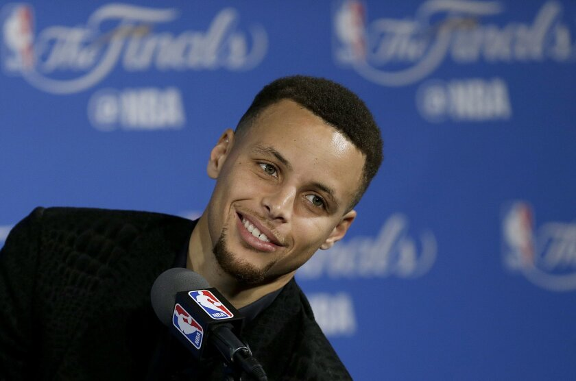 Golden State Warriors guard Stephen Curry smiles during a news conference after Game 1 of basketball's NBA Finals between the Warriors and the Cleveland Cavaliers in Oakland, Calif., Thursday, June 2, 2016. The Warriors won 104-89. (AP Photo/Ben Margot)