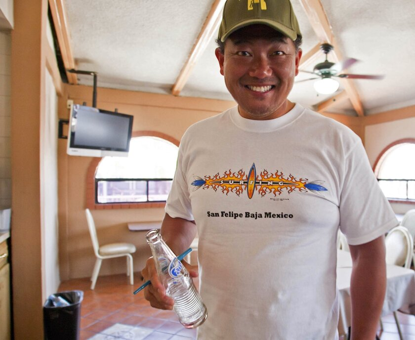 Michael Ng, from Belmont, relaxes inside a hotel after he and other tourists were rescued Monday by the Mexican Navy in San Felipe, Mexico.
