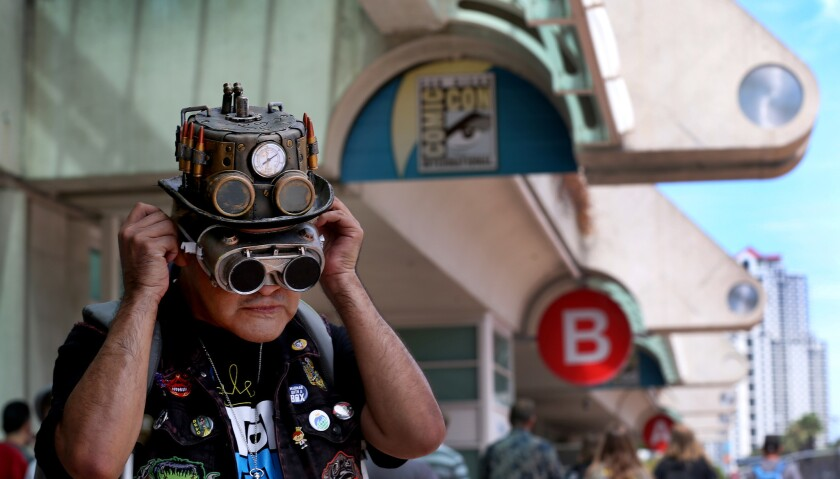 """Ness """"Nesshead"""" Magaña of Pacoima adjusts his steampunk goggles as he waits to get his entry badge to Comic-Con International last year at the San Diego Convention Center."""