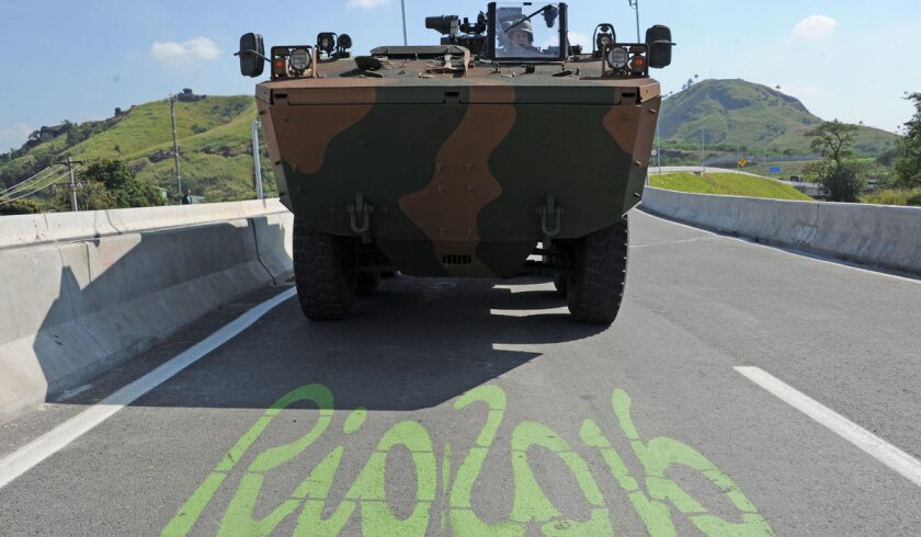 Brazilian soldiers make a convoy during the inauguration of the BRT Transolimpica, an express road that connects Deodoro and Barra da Tijuca.