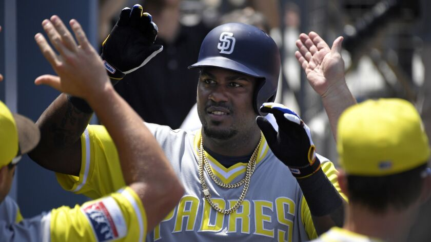 Franmil Reyes is congratulated after hitting a home run Sunday against the Dodgers.