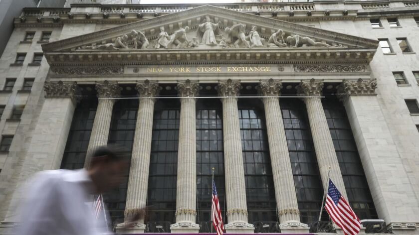 Stocks spent much of the day hovering just below their prior-day closing levels. Above, the New York Stock Exchange.