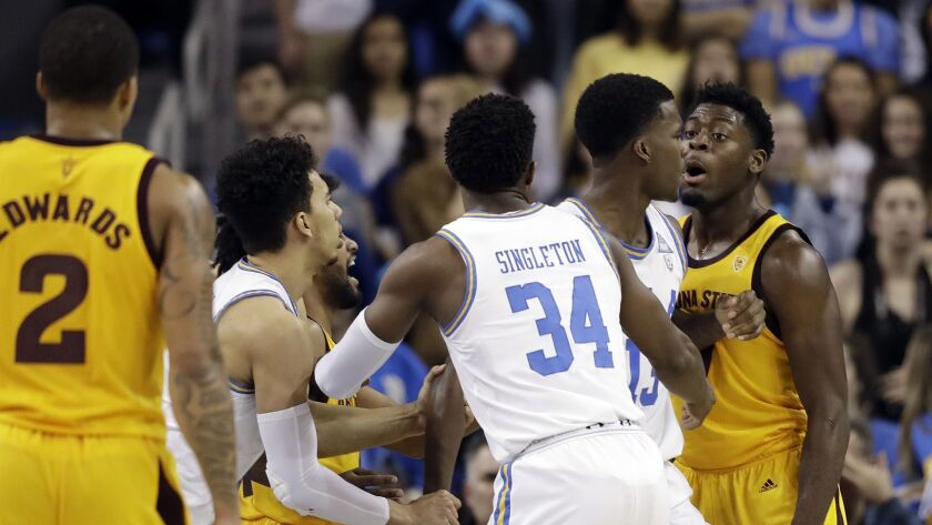 Arizona State guard Luguentz Dort, right, argues with UCLA guard Kris Wilkes, second from right, during the second half.