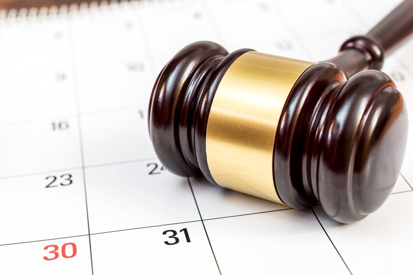 Judge's gavel on the calendar.