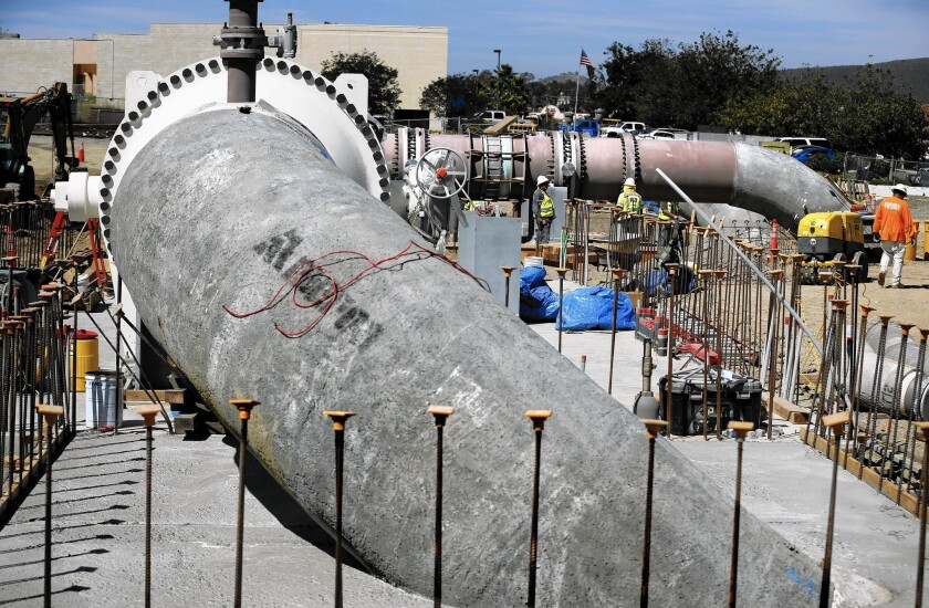 Pipes are installed to carry water from the Poseidon Water desalination plant in Carlsbad, which is scheduled to open in November.