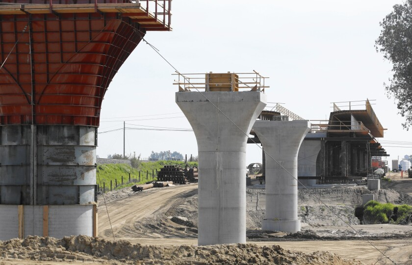 Supports for a 1,600-foot viaduct to carry high-speed trains across the Fresno River are under construction near Madera.