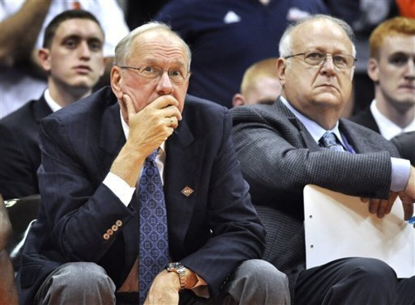 FILE - In this Nov. 14, 2011 file photo, Syracuse basketball coach Jim Boeheim, left, watches the action with assistant coach Bernie Fine, during a college basketball game against Manhattan in the NIT Season Tip-Off in Syracuse, N.Y. Lawyers involved in a slander suit against coach Boeheim are in a New York courtroom arguing over a procedural issue that has veered into salacious allegations about fired assistant coach Bernie Fine's wife. (AP Photo/Kevin Rivoli, File)