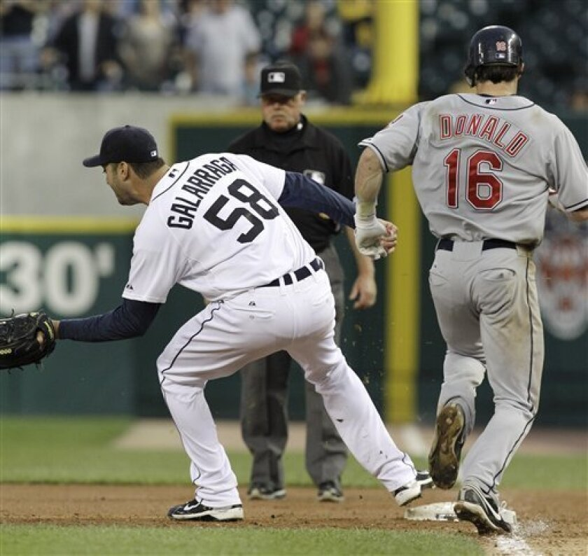 Detroit Tigers pitcher Armando Galarraga (58) covers first base as Cleveland Indians' Jason Donald, right, runs to the base and umpire Jim Joyce looks on in the ninth inning of a baseball game in Detroit Wednesday, June 2, 2010. Joyce called Donald safe and Galarraga lost his bid for a perfect game with two outs in the ninth inning on the disputed call at first base. Detroit won 3-0. (AP Photo/Paul Sancya)