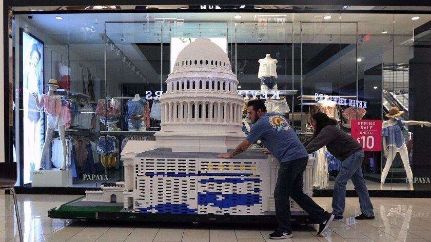 A Lego model of the U.S. Capitol is pushed through the Glendale Galleria for the Lego Americana Roadshow exhibit.