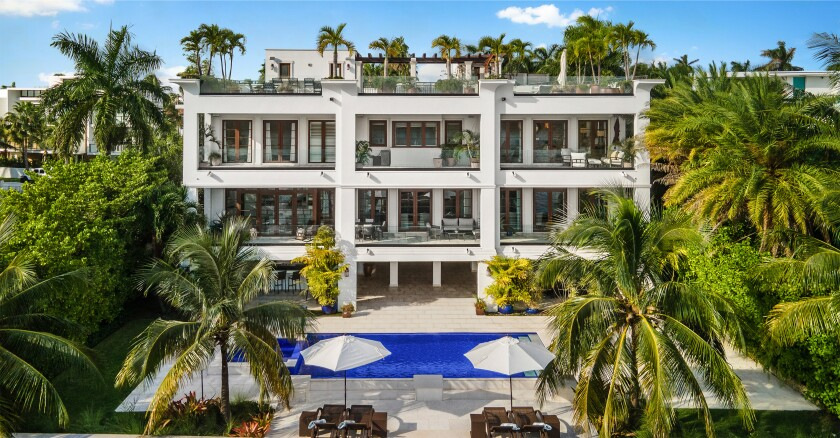 The three-story home on Palm Island is topped by a 5,000-square-foot rooftop deck overlooking Biscayne Bay.