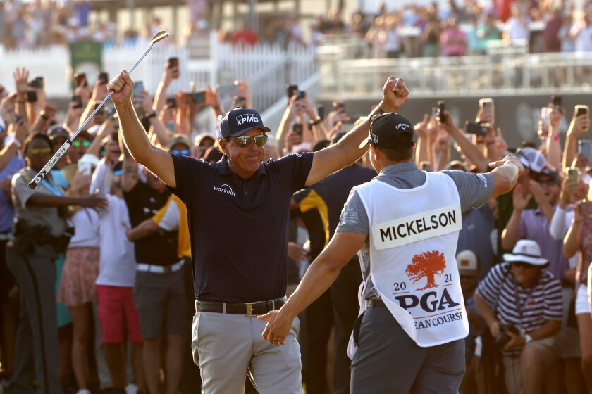 Phil Mickelson celebrates with brother and caddie Tim Mickelson after winning the 2021 PGA Championship.