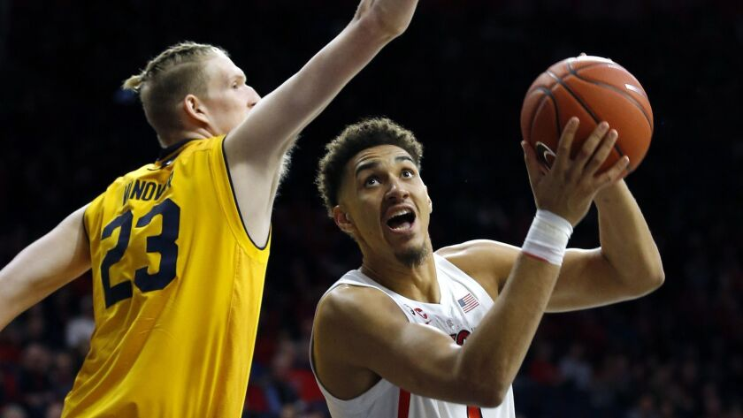 Arizona center Chase Jeter (4) drives on California center Connor Vanover during the second half of