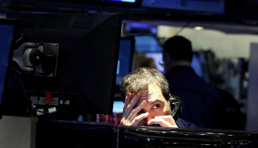 A trader works on the floor of the New York Stock Exchange on Jan. 20.