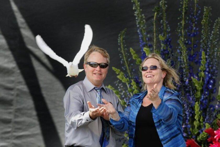 Damon and Brenda Van Dam, release a dove for their daughter, Danielle.