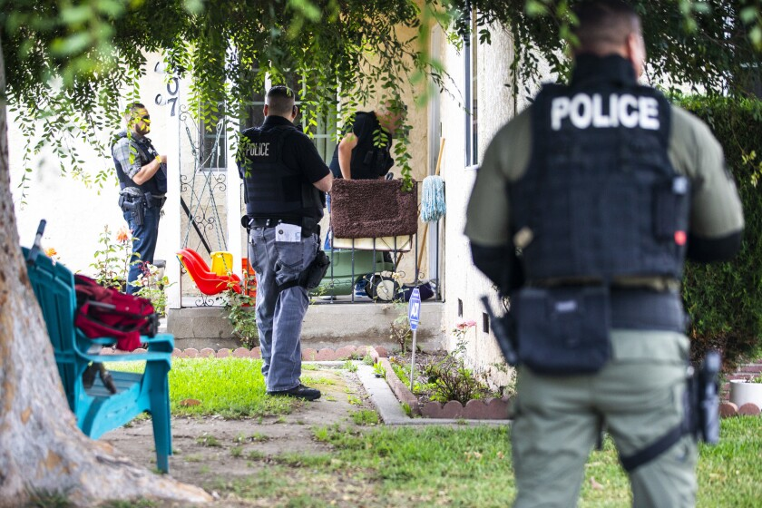 COMPTON, CALIF. - JUNE 10: Immigration and Customs Enforcement fugitive operations team members conv