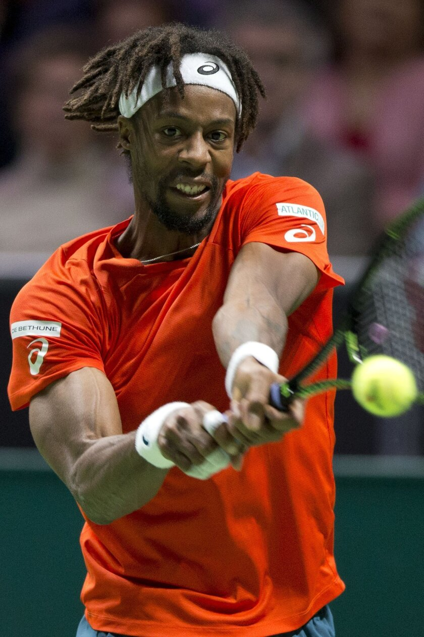 France's Gael Monfils returns against Slovakia's Martin Klizan during the final of the ABN AMRO world tennis tournament at the Ahoy arena in Rotterdam, Netherlands, Sunday, Feb. 14, 2016. (AP Photo/Peter Dejong)