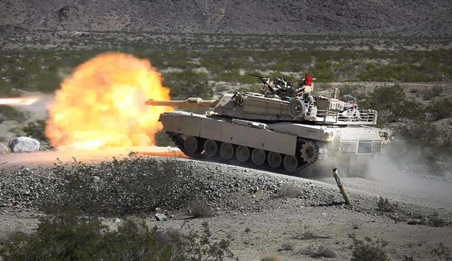 A Marine Abrams Tank fires at the Marine Corps Air Ground Combat Center in 29 Palms where the Marine Corps Ground Combat Element Integrated Task Force is being evaluated to determine if women will be allowed in ground combat units.