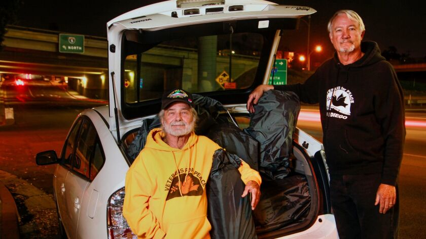 Veterans Stan Levin, left, and Gil Fields, both with San Diego Veterans for Peace's Compassion Campaign, with some of the sleeping bags they distribute to the homeless downtown.