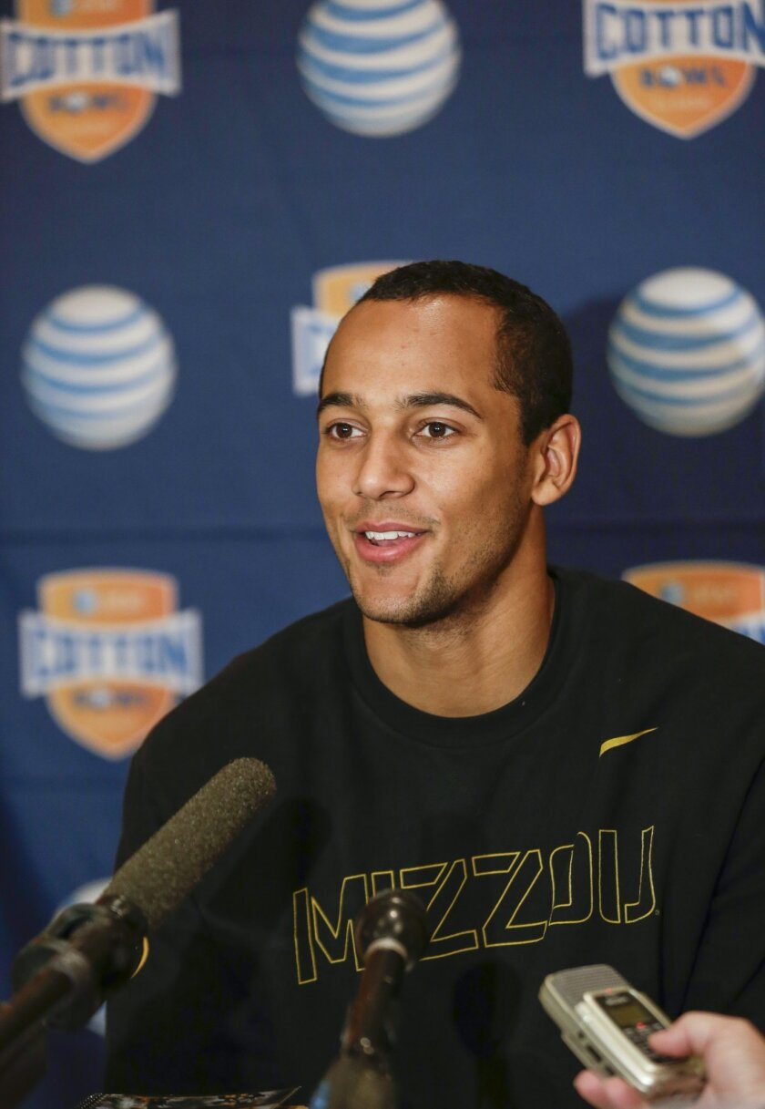 Missouri quarterback James Franklin talks to reporters during an NCAA college football news conference Tuesday, Dec. 31, 2013, in Irving, Texas. Missouri will play Oklahoma State in the Cotton Bowl on Friday.  (AP Photo/Tim Sharp)