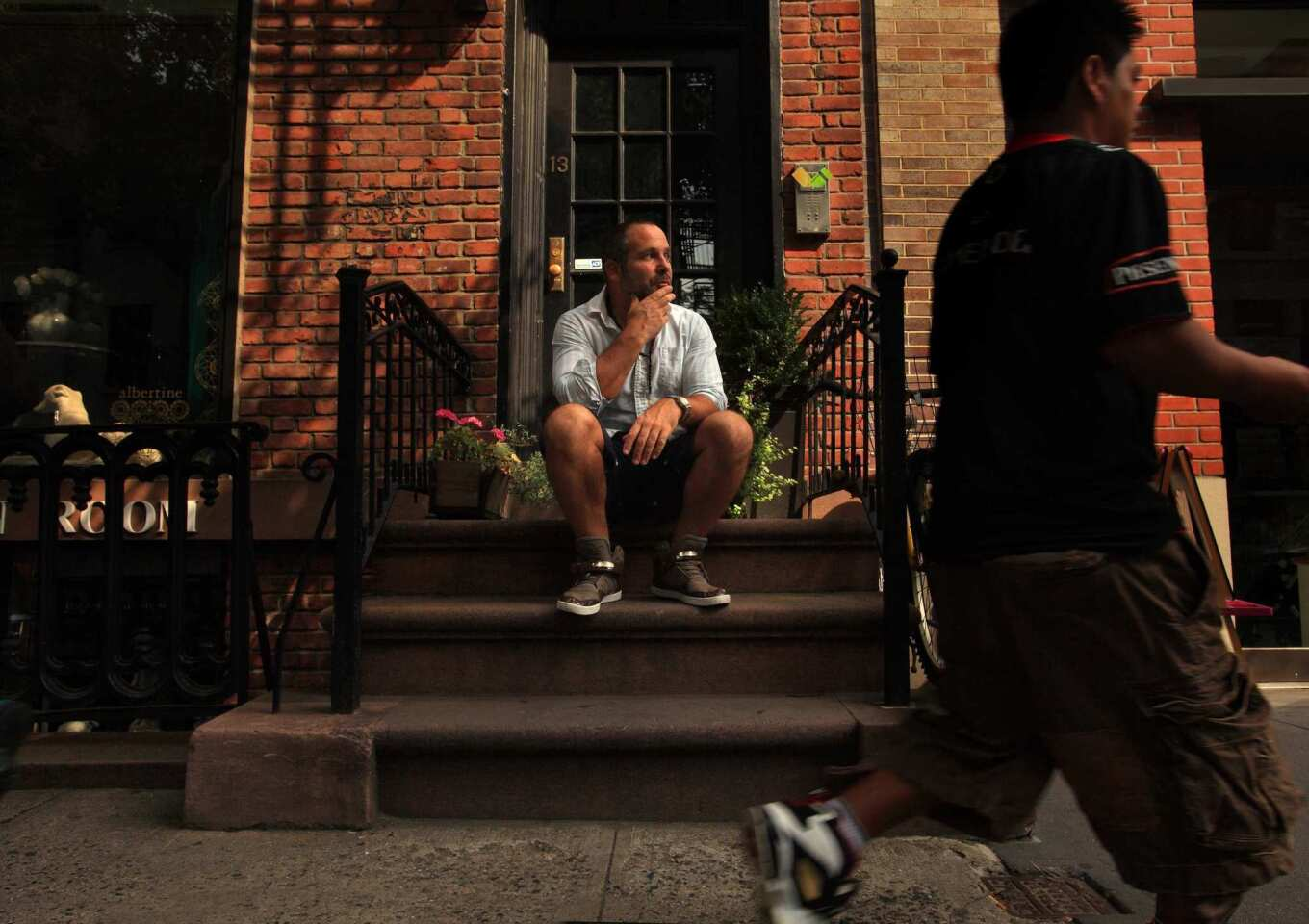 Scott Elyanow, who lives in a 275-square-foot apartment in New York's West Village, spends a lot of time on the front stoop people-watching.