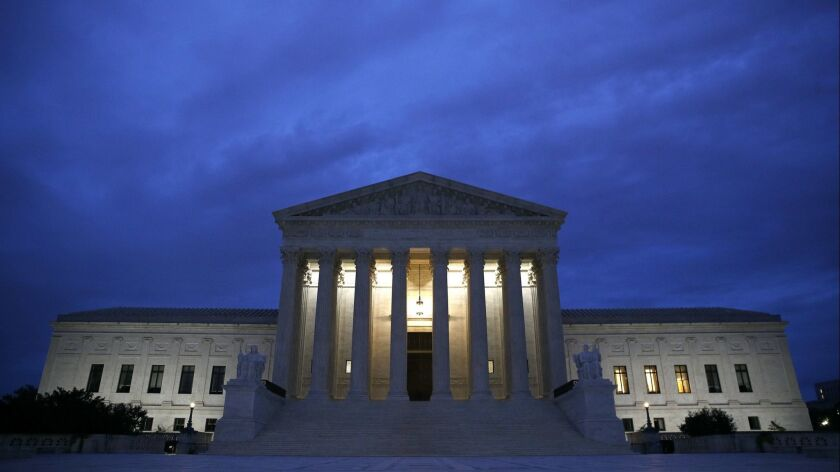 The Supreme Court building is seen at dawn on Capitol Hill in Washington on Sept. 27, 2018.