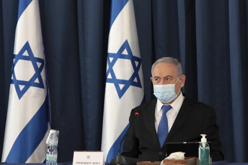 Israeli Prime Minister Benjamin Netanyahu wears a face mask at a Cabinet meeting in Jerusalem.