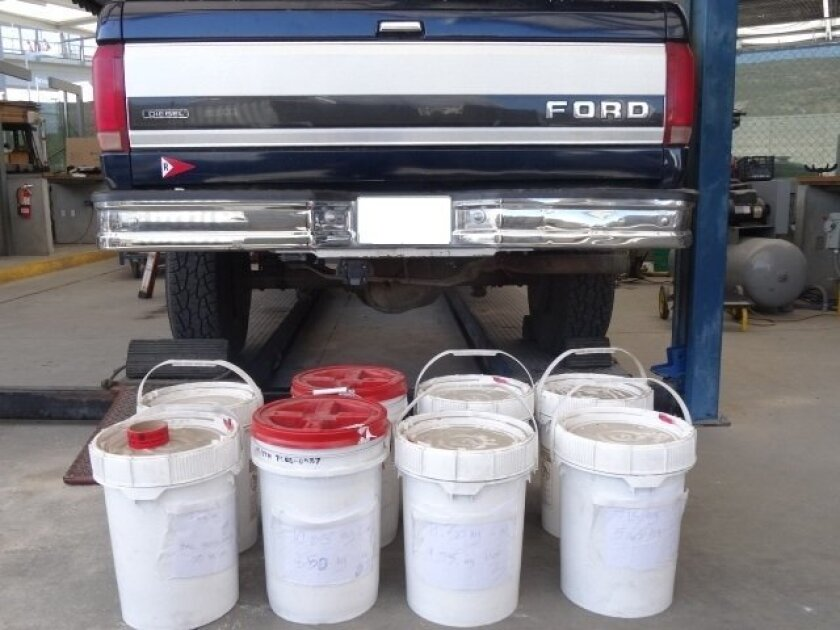 Liquid meth seized from the gas tank of a pickup.