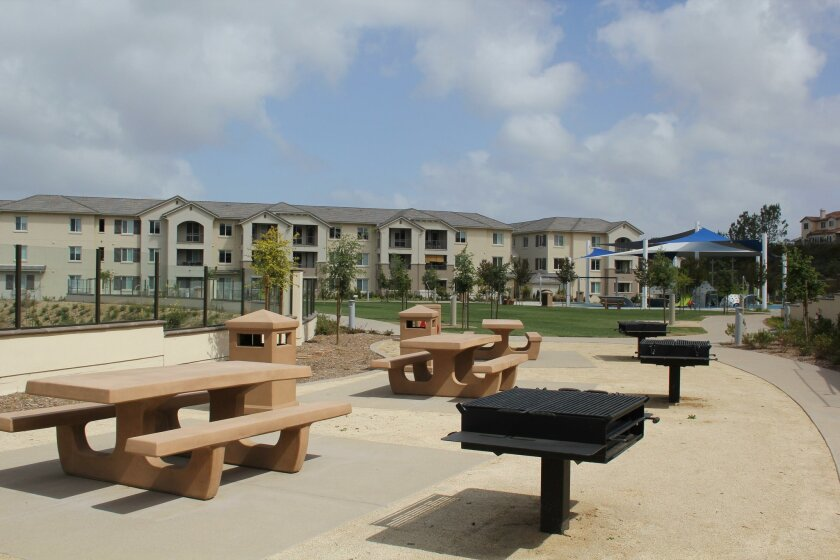 The new park has barbecue pits and picnic tables.