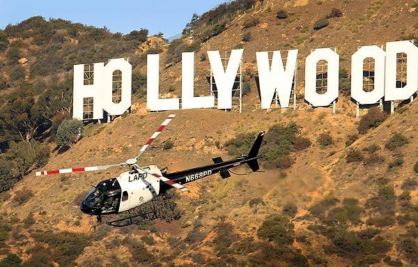 A Los Angeles Police Department helicopter searches steep, brushy terrain below the Hollywood sign, where a man's head, two feet and two hands were found. The head was discovered at 2:30 p.m. Tuesday near a trail in Bronson Canyon Park by two people walking nine dogs. The first hand was found Wednesday morning and the second was found in the afternoon, all in the same general location. Then, as police were about to leave for the day, two feet were found.