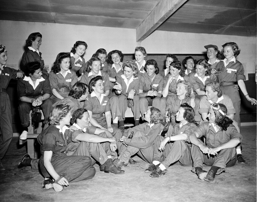 Jacqueline Cochran (center), gesturing, is surrounded by female pilots during a bull session in the ready room at Avenger Field, near Sweetwater, Texas, on April 25, 1943. Cochran, an accomplished flight captain, is director of the Women's Airforce Service Pilots