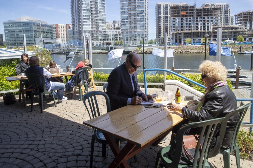 In May, patrons dine on a restaurant patio in Stamford, Conn.