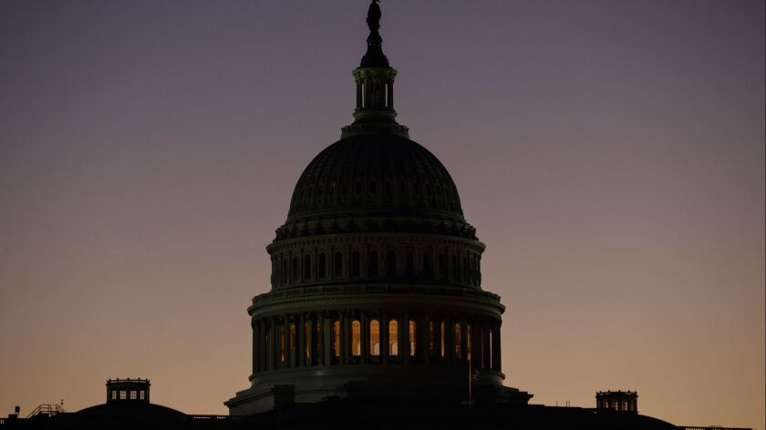 The U.S. Capitol Building Dome is seen before the sun rises in Washington, Tuesday, Dec. 18, 2018. (