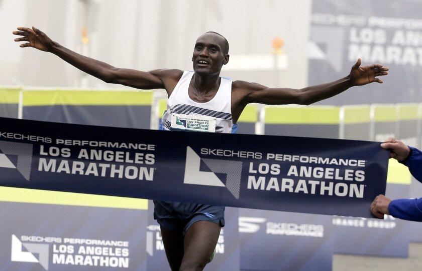 Weldon Kirui celebrates as he wins the Los Angeles Marathon, Sunday, Feb. 14, 2016, in Santa Monica, Calif. (AP Photo/Chris Carlson)