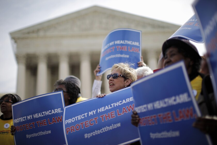Supporters of healthcare reform rally in front of the Supreme Court in Washington on March 12, 2012. The justices are expected to decide this month on the fate of insurance subsidies for millions of people who live in states with federally run exchanges.