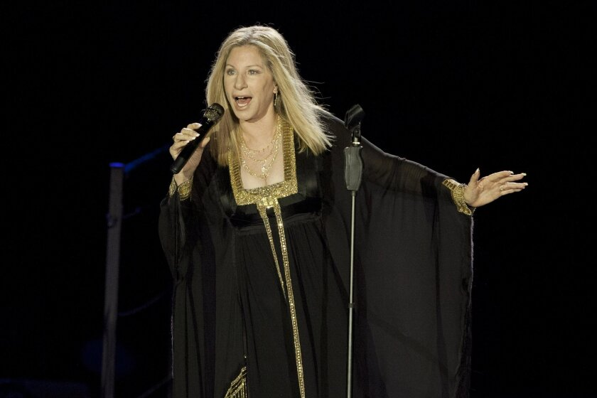 """FILE - In this June 20, 2013 file photo, singer Barbra Streisand performs during her concert in Tel Aviv, Israel. Streisand's latest album, """"Partners,"""" was released on Tuesday, Sept. 16, 2014. (AP Photo/Dan Balilty, File)"""