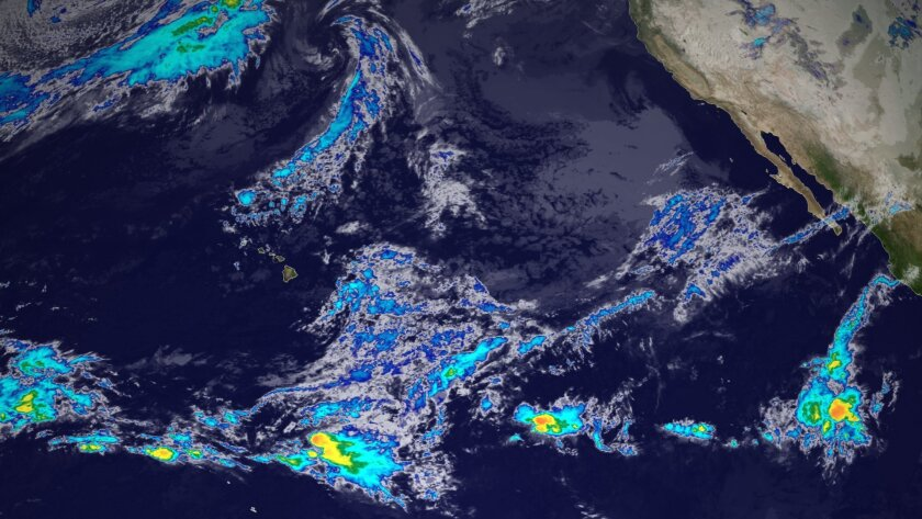 """NOAA says that the new GOES-15 satellite today """"took its first infrared image as the operational geostationary satellite positioned over the Pacific - called GOES-West. This image shows a portion of that first image. The clouds are colorized based on their temperature, an indication of storm intens"""