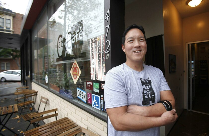 Tony Wang, owner of the Cat Cafe, takes a break outside the business recently. He opened the coffee shop and cat-adoption enterprise in January, and hopes to extend the downtown San Diego cafe's hours past 3 p.m. and hold more events next year.