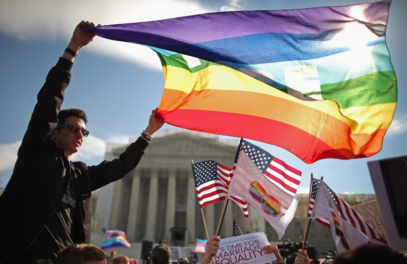 Activists rally outside the Supreme Court building in Washington, D.C., during oral arguments in the case that led to parts of the Defense of Marriage Act being struck down last March.