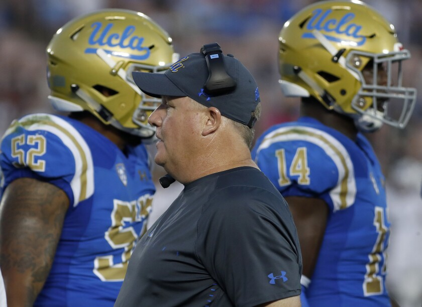 Chip Kelly works the sideline in his first game as UCLA's head coach at the Rose Bowl in Pasadena on Saturday.