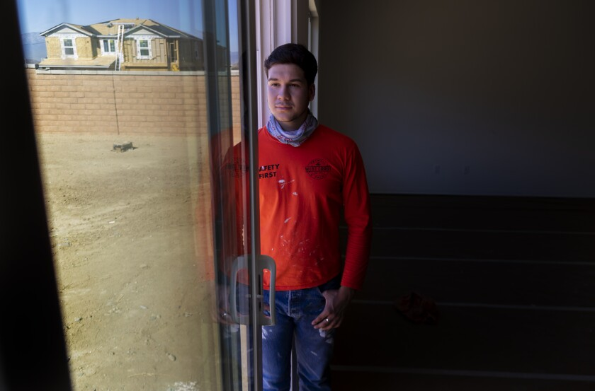 Vincent Aguayo, a first-year student at Cal State Sacramento, is shown at a new housing development in Riverside.