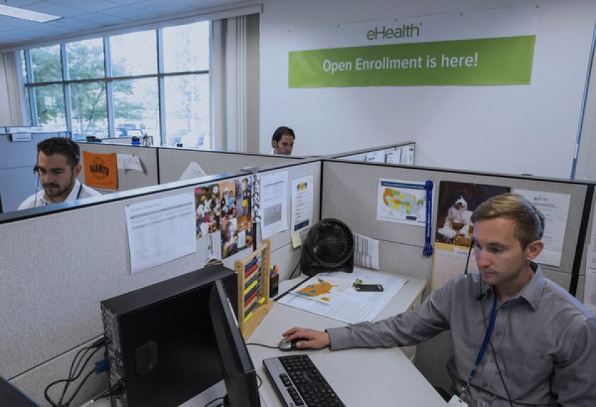 Call operators answer phones on the first day of Obamacare at an eHealthInsurance Services Inc. call center in Sacramento.