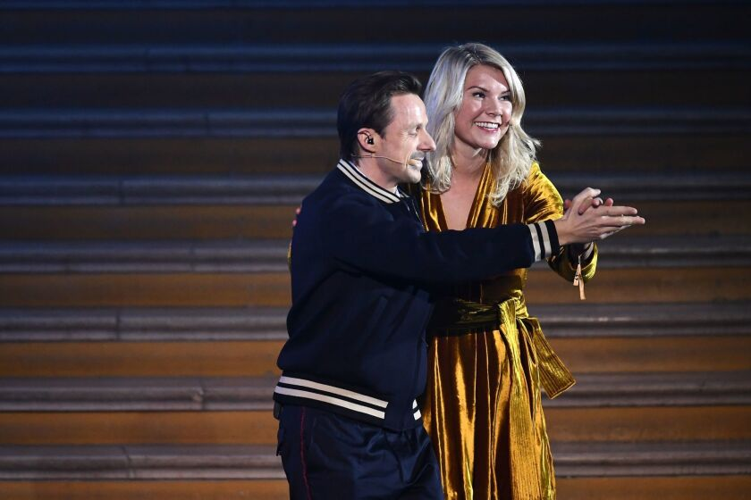 Olympique Lyonnais' Norwegian forward Ada Hegerberg (R) dances with French DJ and producer Martin Solveig after receiving the 2018 FIFA Women's Ballon d'Or award for best player of the year during the 2018 FIFA Ballon d'Or award ceremony at the Grand Palais in Paris on December 3, 2018. - The winner of the 2018 Ballon d'Or will be revealed at a glittering ceremony in Paris on December 3 evening, with Croatia's Luka Modric and a host of French World Cup winners all hoping to finally end the 10-year duopoly of Cristiano Ronaldo and Lionel Messi.