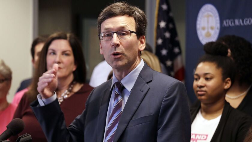 "Washington state Atty. Gen. Bob Ferguson speaks at a Seattle news conference announcing a lawsuit challenging the Trump administration's Title X ""gag rule"" on Feb. 25."