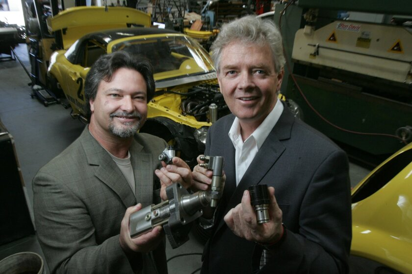 John Reed (left) and Peter Petersen of American Repower Resources in Carlsbad display fuel control valves the company uses to convert dirty diesel engines to run on natural gas.